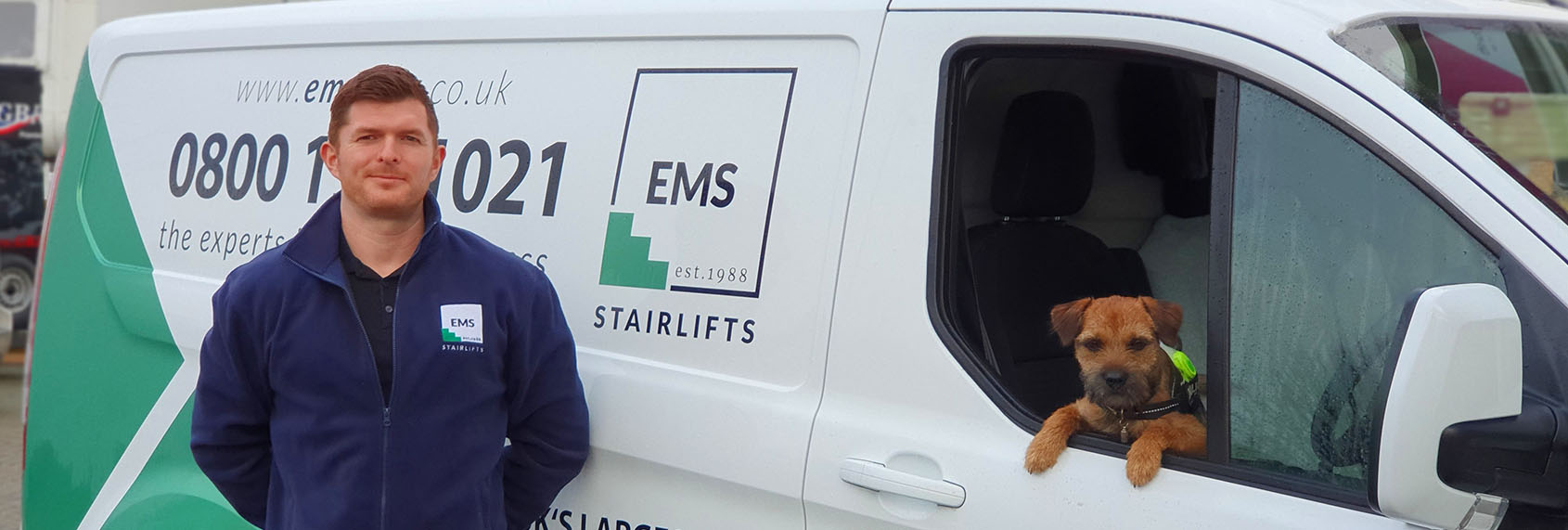 Mobility and Stairlift Specialist in front of EMS vans
