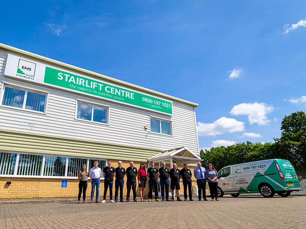 EMS Staff in front of their stairlift centre