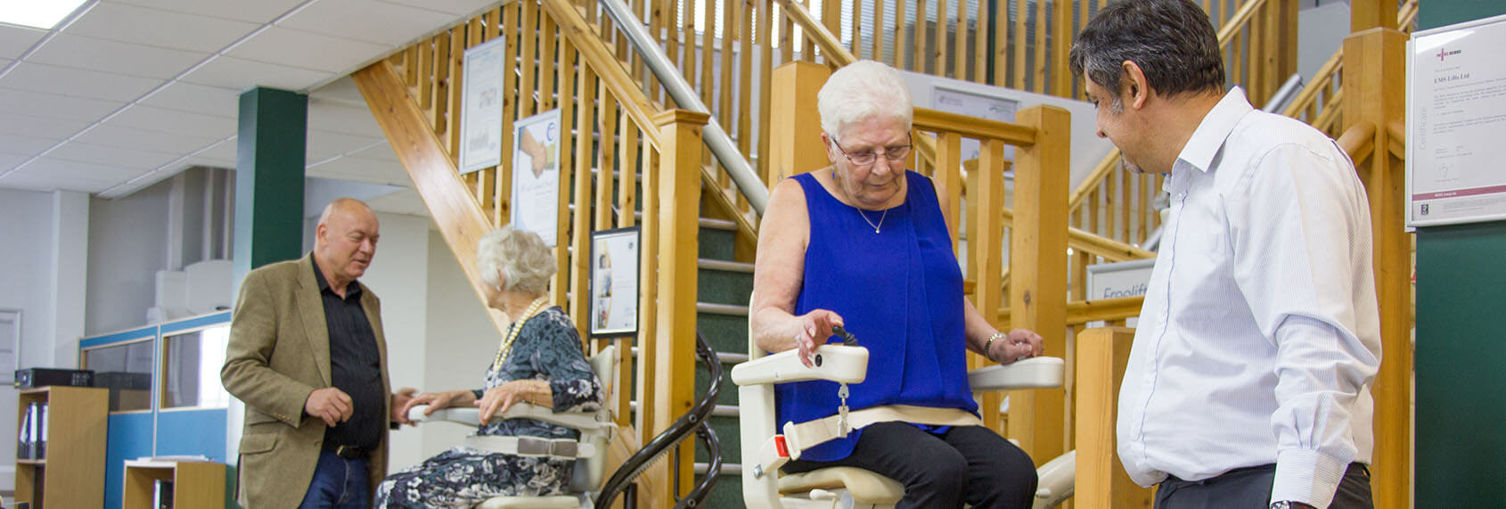 Two Stairlfit Advisors helping women choose a stairlift